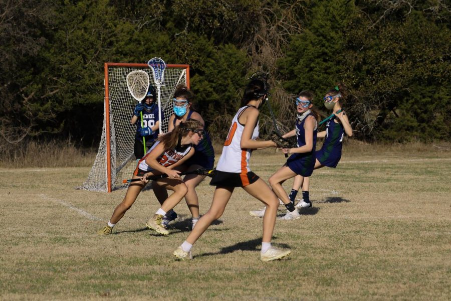 Sarah Poppe '22 rolls off of her defender to create an opening to make a shot. With pinpoint accuracy, the Mcneil goalie was not able to save it, gaining a point for the Warriors.