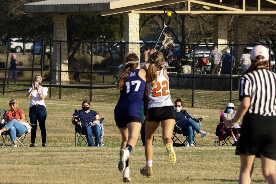 Sarah Poppe '22 completes a draw to herself and catches the ball. The Mcneil defender was not able to check the ball out of her stick.