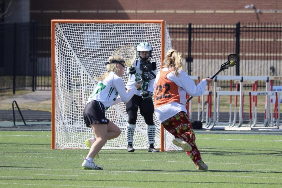 Sarah Poppe '22 beats her defender to the goal to make an amazing shot for the Warriors. An isolation play allowed for a clear lane to cage.