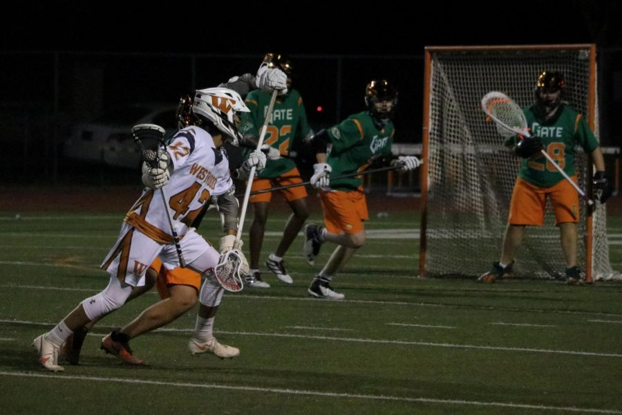 Alex Serpas '21 finds a clear lane to the cage and runs to take a shot. The Gator goalie wasn't able to block the shot, giving the point to the Warriors.
