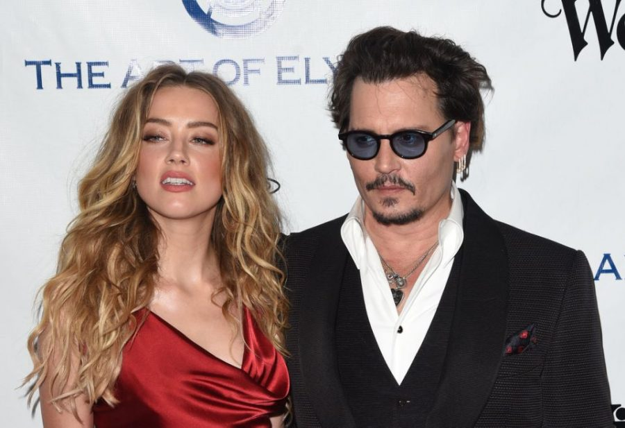 The+courtroom+battle+between+Johnny+Depp+and+Amber+Heard+goes+back+to+2016%2C+and+continues+even+to+this+day.+The+case+of+people+not+believing+Mr.+Depp+when+he+claimed+Ms.+Heard+was+abusing+him+shows+society%27s+toxic+perception+of+the+notion+women+can%27t+abuse+men.+Photo+courtesy+of+Yahoo%21+News.