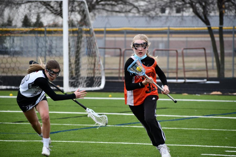 Tripping up her defender, Megan Molloy '21 sprints down the field against Prosper. She gained possession from a ground ball fight with the player she was defending.