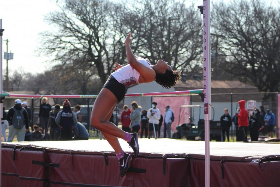 Daisha Kirkpatrick '22, a student from Round Rock High School, gracefully arches over the pole during the High Jump event.