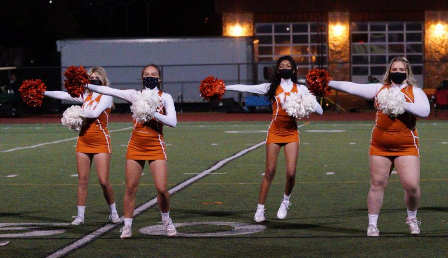 At halftime, cheerleaders Carys Wellings '22, Claire Pitre '21, Anya Vadayar '23, and Hannah Simonsen '21 perform a routine. This was at the varsity boy's soccer game vs. Round Rock.