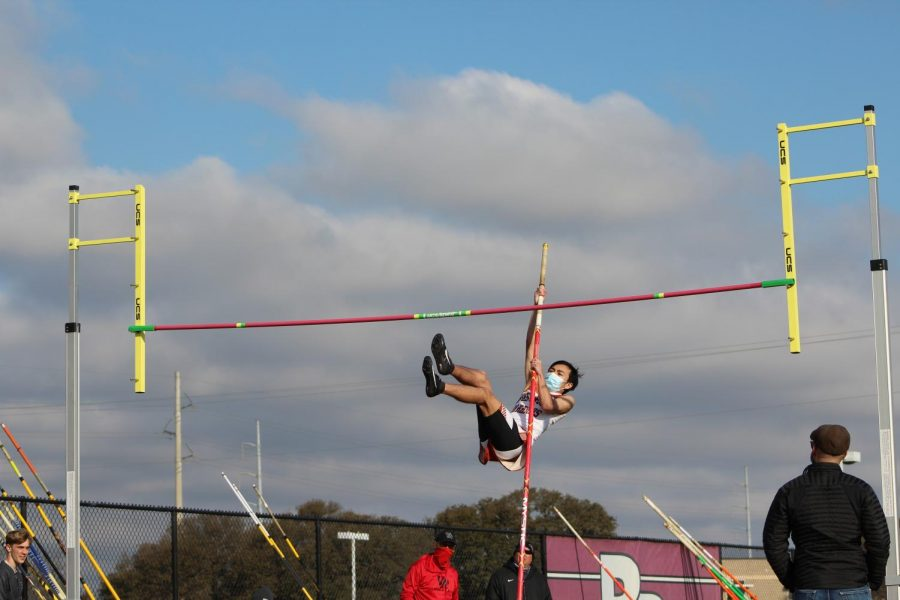Collin Le '21 attempts to swing over the pole during the pole vault event at Dragon Stadium on Saturday, Mar. 6.