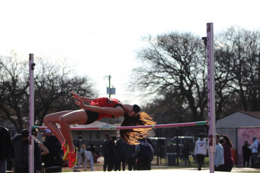Rachel Pinkston '22, a Round Rock High School student, launches herself across the pole during the Varsity High Jump event.