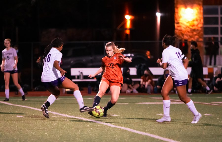 With two opposing players on each side, forward Katelyn Woodruff