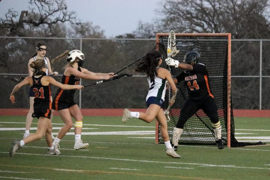 Goalie Makhia Elliot '21 saves shot made by the Mcneil attack with help from Sam Newlin '22.