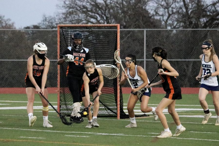 Bridgette Moravec '24 scoops up the ground ball after a missed shot by the Mavericks. The previous shot was saved by goalie Makhia Elliot '21.
