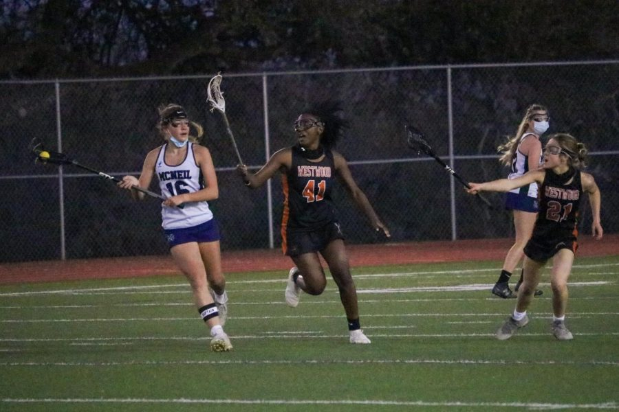 Kaybee Beggs '21 defends Maverick by pushing her towards the sideline, forcing her to make a bad pass. The pass was incomplete, causing the ball to fall, giving the Warriors possession.
