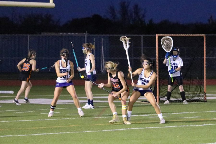 Attacker Sarah Poppe '22 looks for open pass as the Maverick defense double teams her. She made a complete pass to midfielder Sam Newlin '22, who settled the ball at the top.