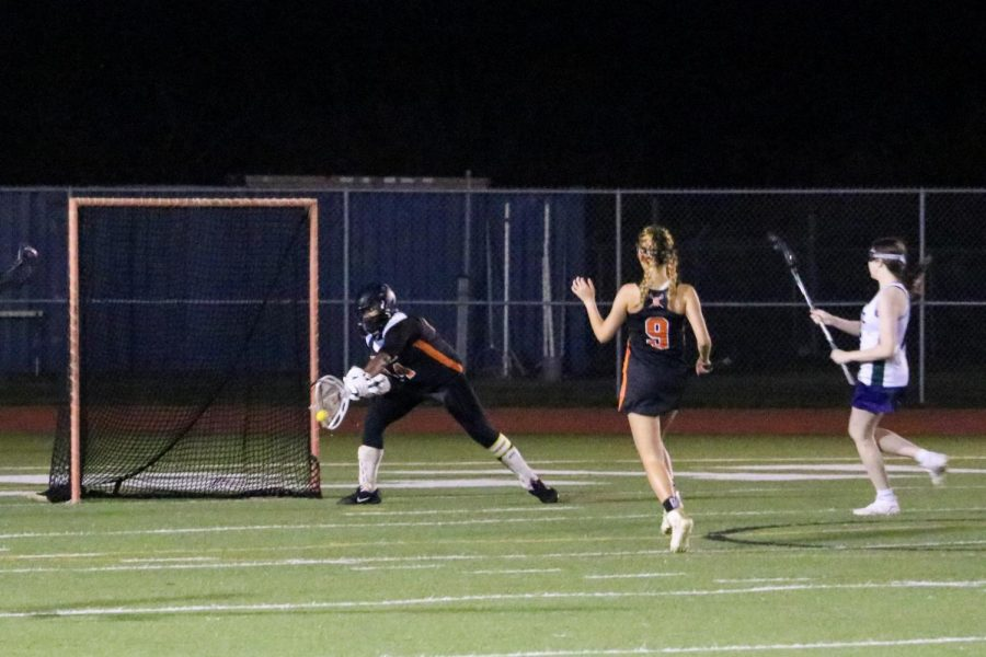Makhia Elliot '21 amazingly saves a shot made by a Maverick as she ran back into the goalie circle. She had previously made a clear near the 20-yard line when the opposing team intercepted the clear, and Elliot ran back just in time to save the goal.