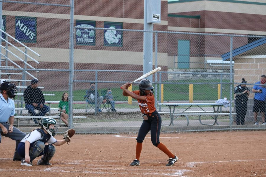 Quincy Jones '21 gets ready to swing her bat and hit a single. Jones was able to score the Warriors a point.