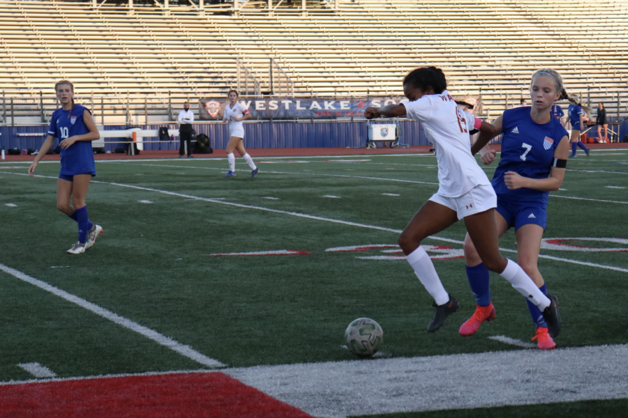 Deepti Choudhury 21 quickly steals the ball from her opponent. She was able to dribble 10 yards up the field before passing the ball to teammate Leah Wang 23.