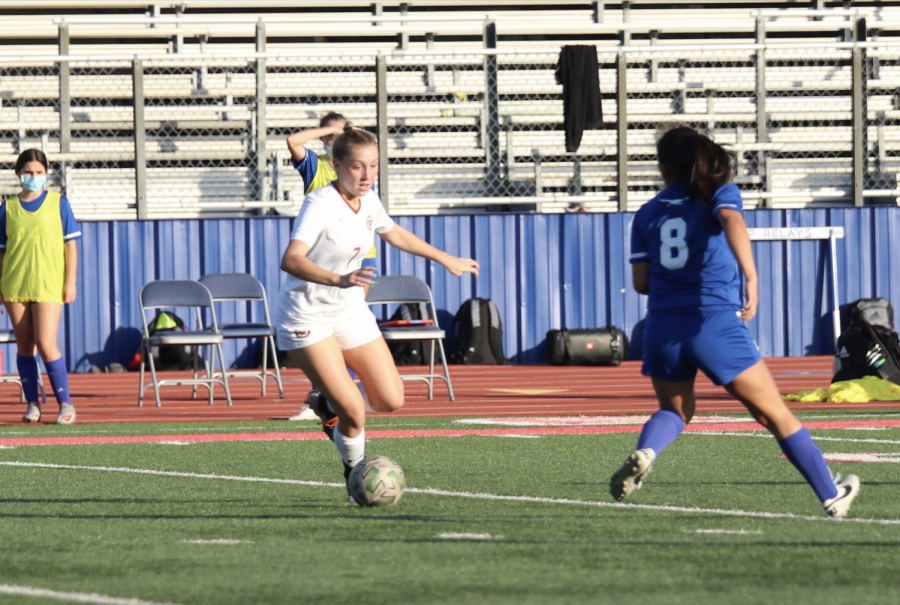 Skylar Zinnecker 23 fakes out her opponent with a scissor technique. She was able to get a shot on goal.