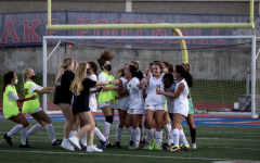 The team rejoices after the buzzer hits. The Warriors won the game 2-1 allowing them to advance to round two.