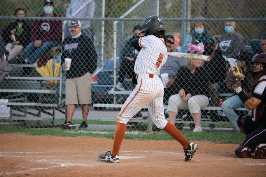 Quincy Jones ' 21 gets ready to hit a single. Jones was able to score the Warriors a point.