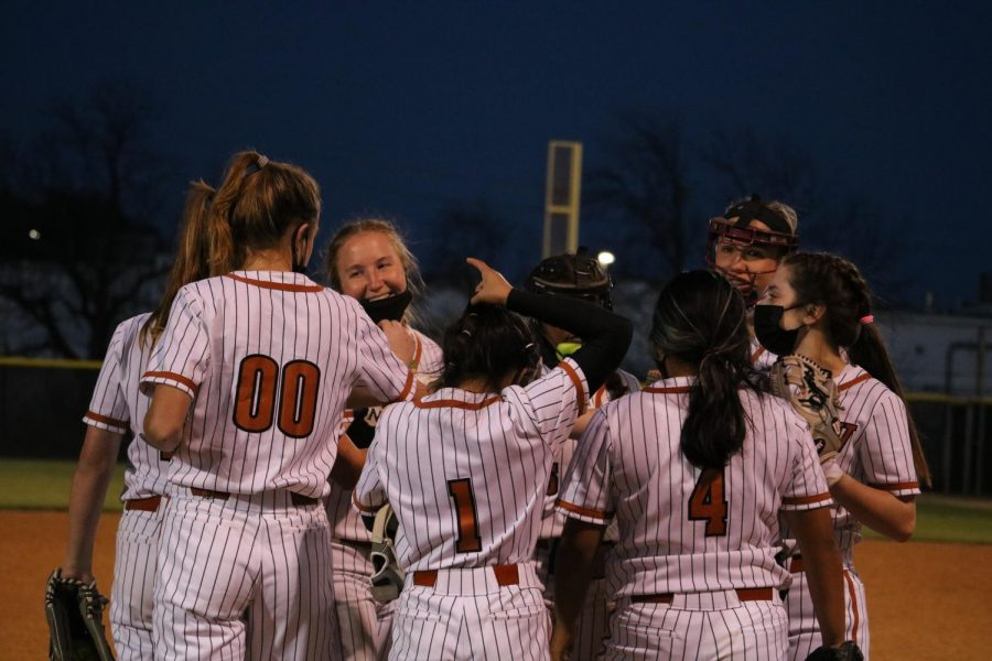 The team calls in for a team huddle before starting the sixth inning. Despite their best efforts, the Warriors lost game 9 -2.
