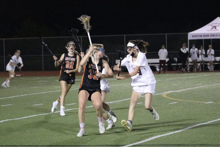 Laura Moravec '22 maintains the ball while getting double teamed by her defenders. She made a pass to open attacker Sarah Poppe '22, who was able to make a goal.