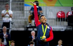 Simone Biles waves to the audience after winning a gold medal at the 2016  Olympics held at Rio de Janeiro, Brazil. Photo courtesy of Danilo Borges.