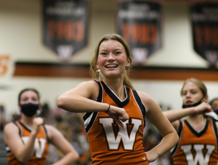 Ashlin Swasey 22 leads her team during the pep rally with cheers. The cheerleader team was able to teach the students the traditional football cheer performed during each football game.
