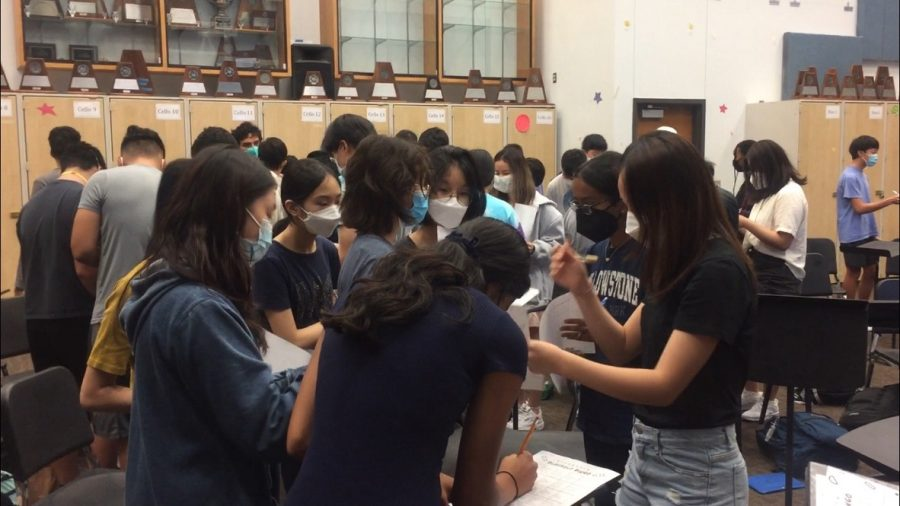 Symphony students rapidly exchange blackout bingo sheets in a race to finish first