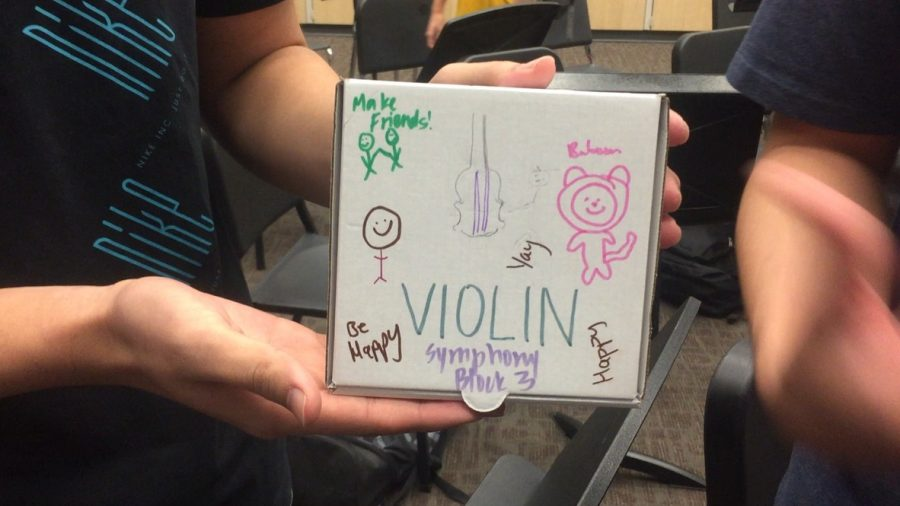 Symphony violinists display their sections Wonderful Words box