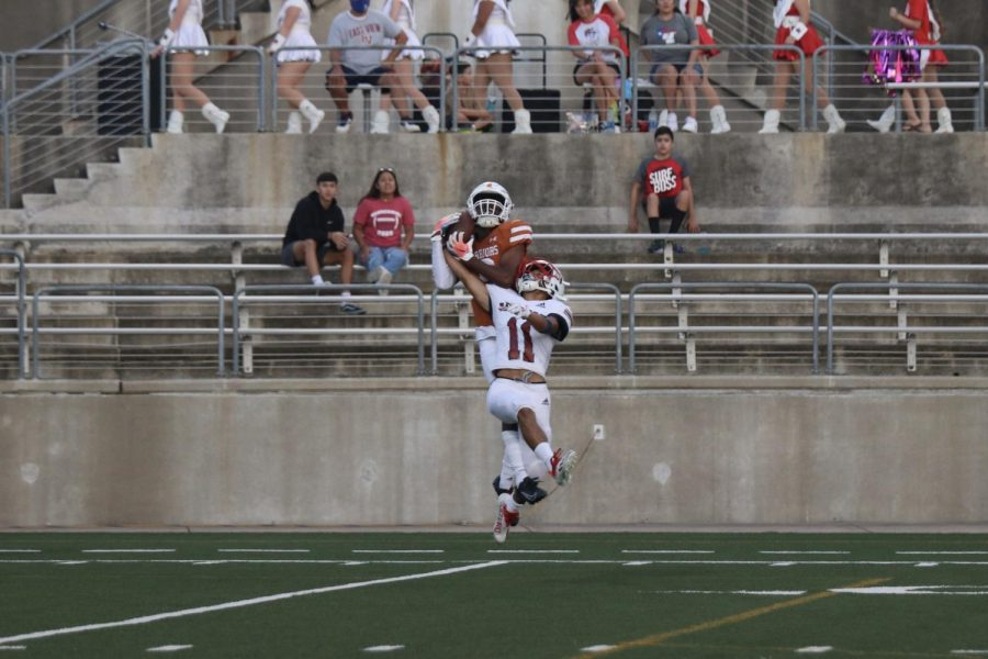 Wide receiver Jaiden Webber 23 catches the ball and scores the Warriors first touchdown of the game.