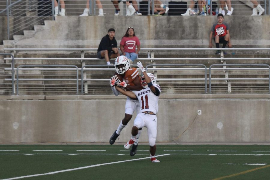 Despite a tight defense on wide receiver Jaiden Webber 23, he is able to catch the ball and run to the endzone, scoring the Warriors first touchdown.