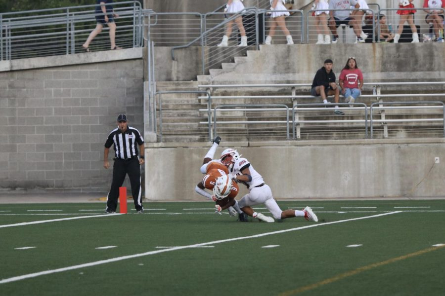 Wide receiver Jaiden Webber 23 catches the ball and runs to the endzone despite a tight defense on him. He was able to score the Warriors first touchdown.