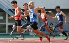 Athletes with prosthetics compete in the 100M dash at the 2020 Paralympics. Photo courtesy of the Japan Times