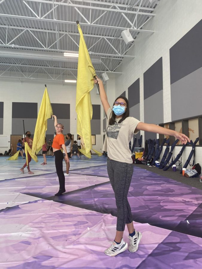 Trinity Castro 25 waves her flag for Color Guard. The new studio makes it easier for the dancers to perform with correct spacing.