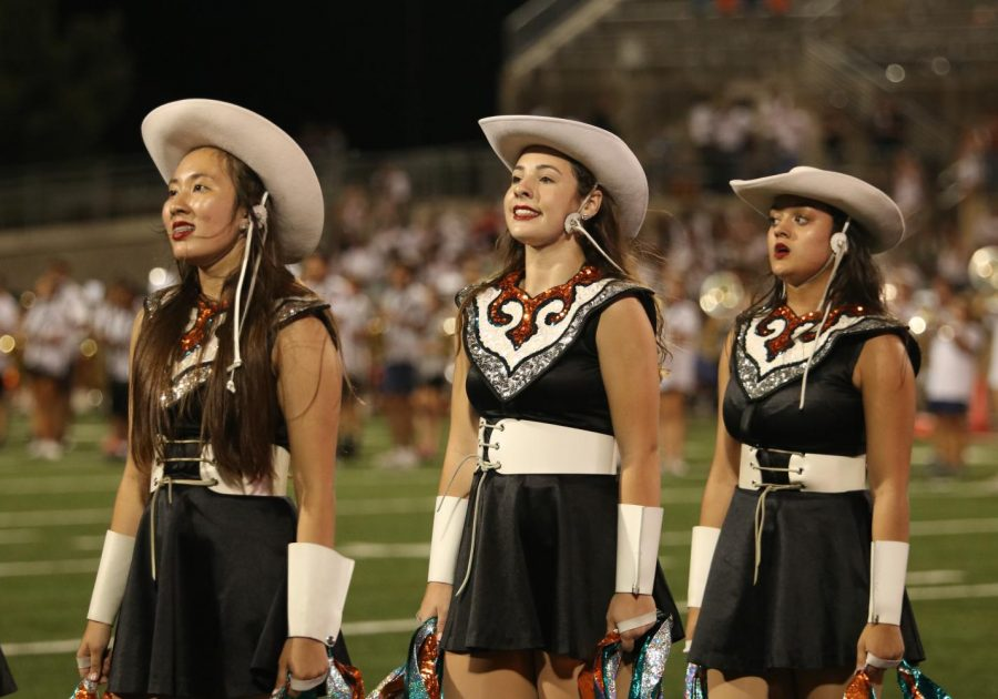 Susan Hamilton 23, Hannah Bresser 24, and Sofia Baruah 23 stand facing the Warriors home side. The SunDancers were performing alongside the Warrior band during halftime to get the crowd hyped up.