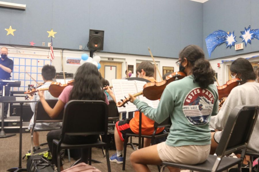 Orchestra students rehearse under the guidance of Mr. Thompson. During this rehearsal, they worked on being more cohesive as an ensemble.