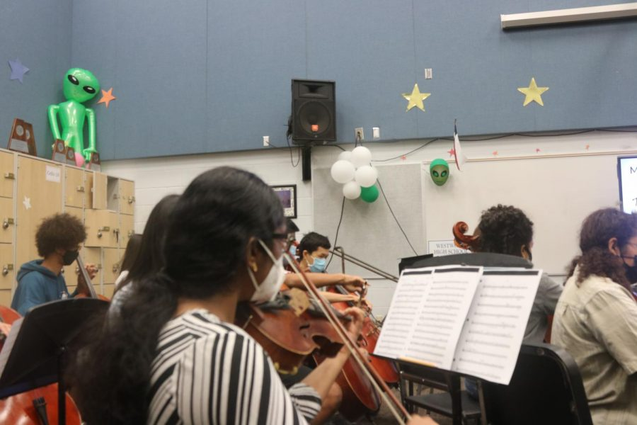 Jhanvi Karthik 23 plays her violin during Orchestra class. The Philharmonic orchestra rehearsed the Holst Moorside Suite piece.