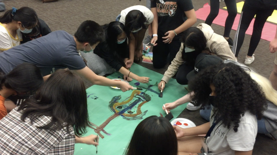 Second violinists paint their section poster