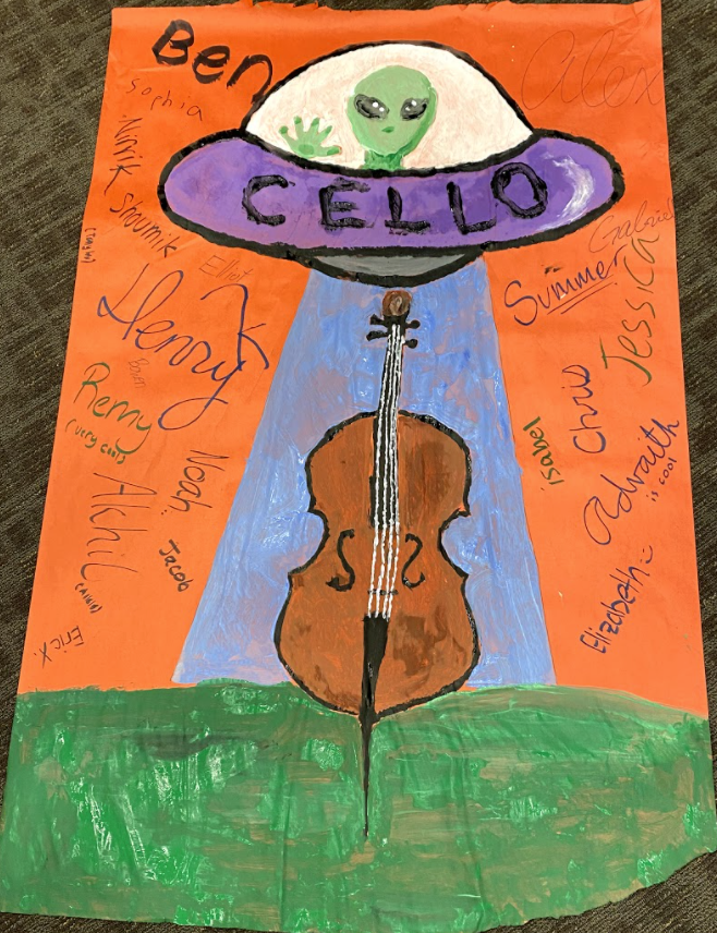 The finished Cello section poster, featuring Charle the inflatable alien.