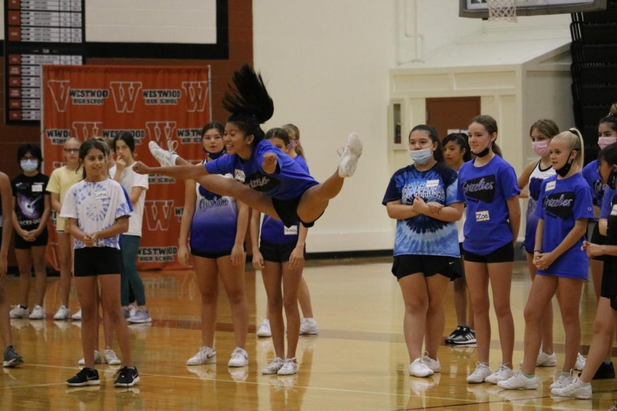 Middle schooler and future warrior Aliya Yu shows her outstanding jump to the rest of her friends after introducing herself. Just being in the environment is really cool, Aliya said. She is more than excited to try out for the cheer team next year.