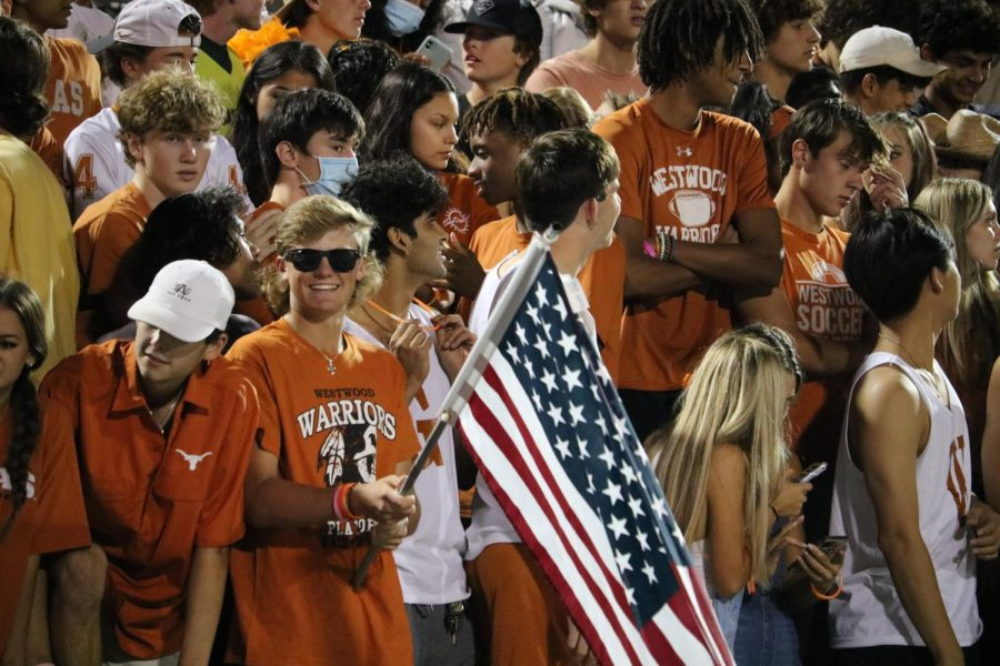 Luke Hagen 23 waves an American flag. The students in the student section were energetic all throughout the game.