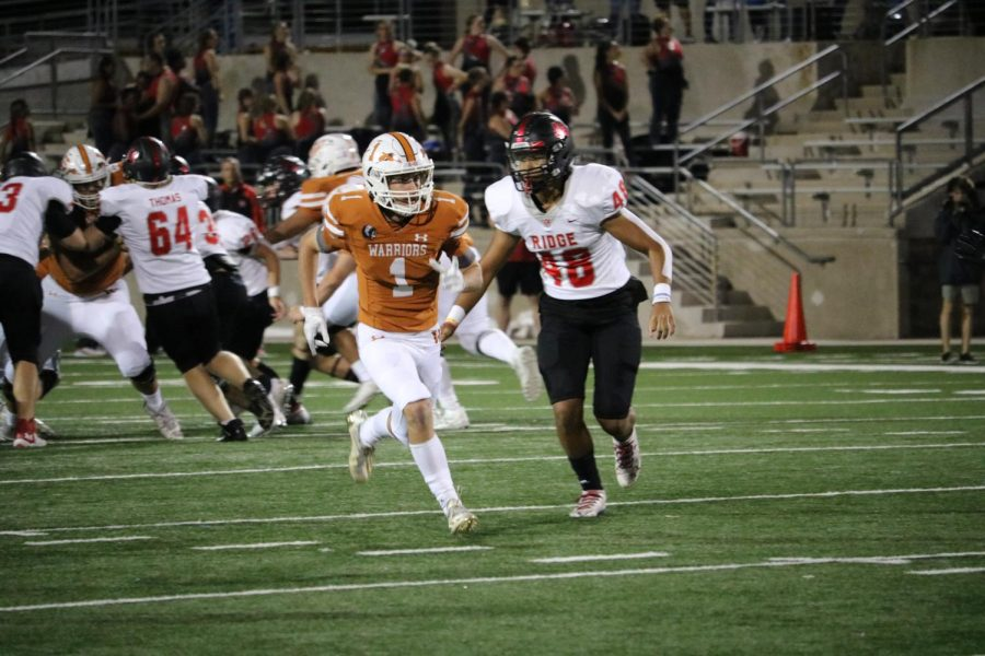 Grant Jaeger 23 runs to catch the ball. He was stopped in his tracks by a Vista Ridge Raider.
