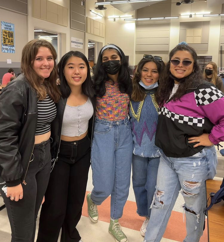 Lauren Jackson 23, Katie Liu 23, Zaina Jafri 23, Faith Gonzalez 23, and Promise Salinas 23 wore outfits reminiscent of the 1980s for Decades Day. These bright colors and baggy pants were extremely popular during that time. [My sweater] was actually a hand-me-down from the 80s, Gonzalez said. I thought this would be the perfect opportunity to wear it.