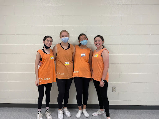 Zoe Bellomio '24, Meredith Strain '23, Susan Hamilton '23, and Claire Peptiprin '23 stand together for a photo halfway through the clinic. The clinic was lively throughout the three-hour time span.